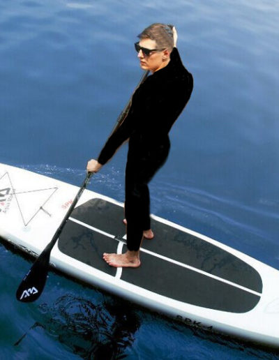 stinger suit paddle boarder